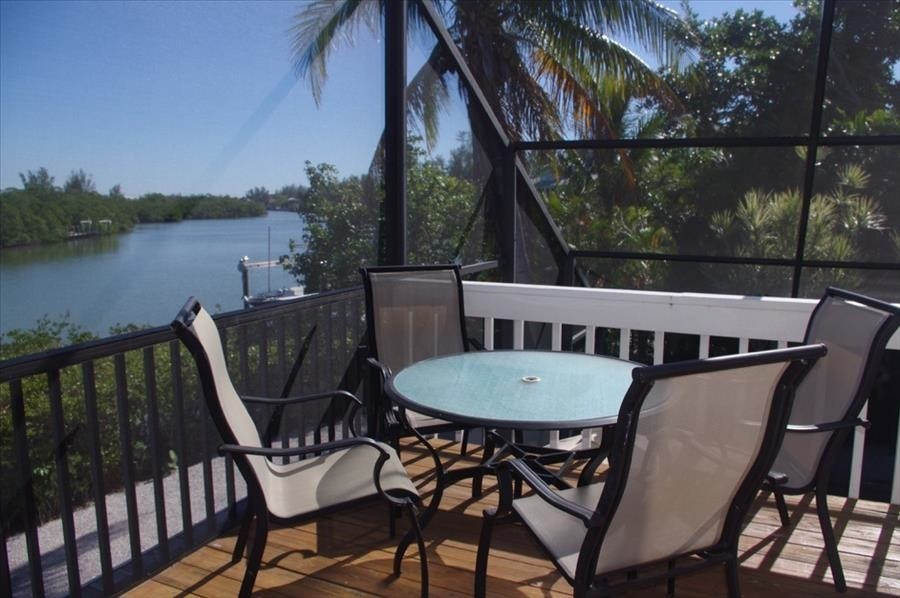 Enjoy meals and a water view out on the deck.