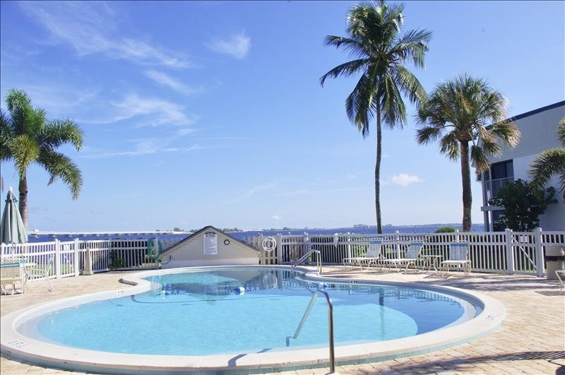 The outdoor heated pool has a bay and causeway view.