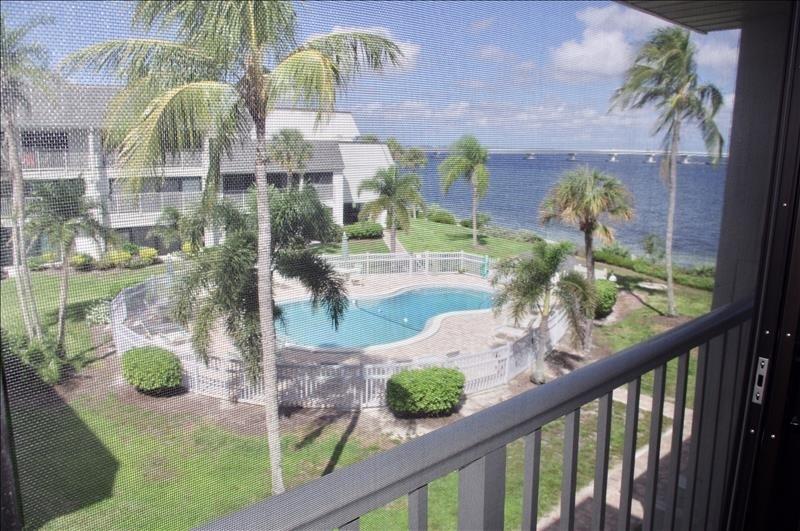 Screened lanai has pool, bay and canal views.