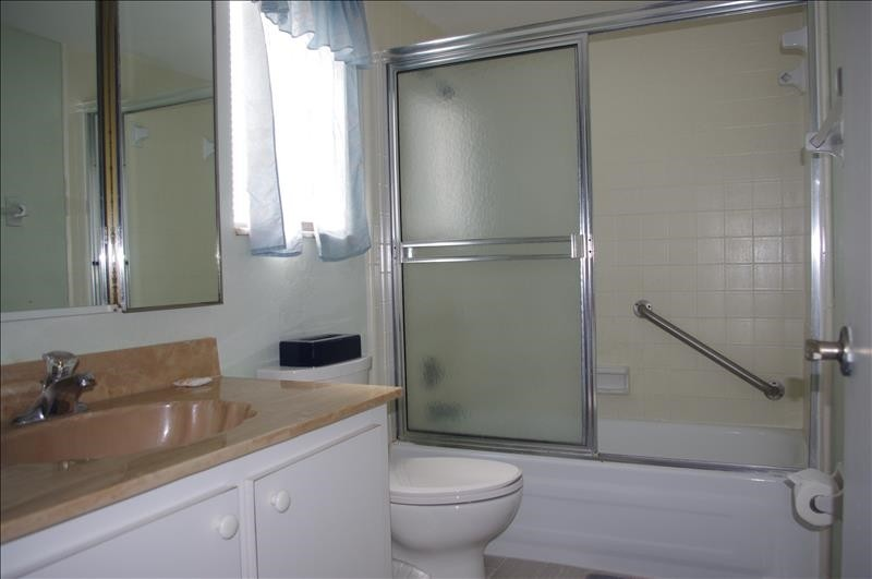 There is a tub/shower and single vanity in the master bath.