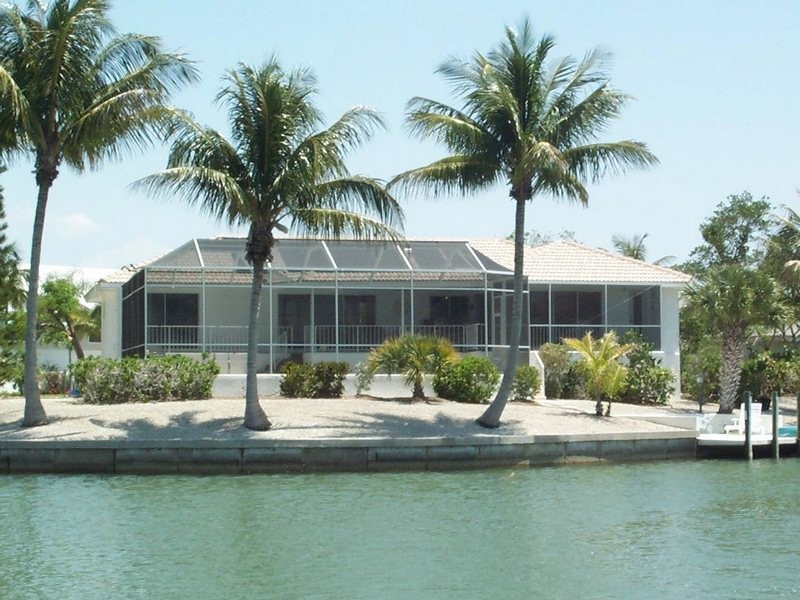 This lovely Shell Harbor home has a dock and heated pool.