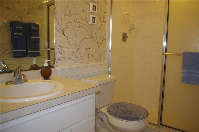 The master bath has a single vanity and shower.