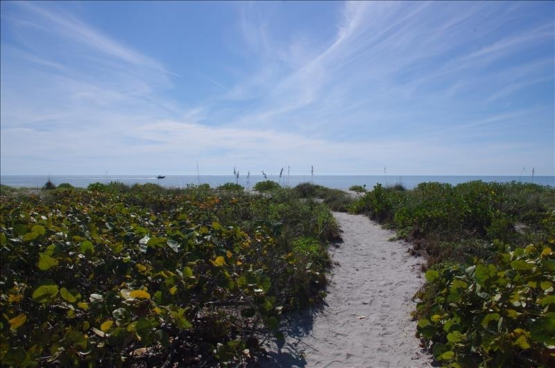 Follow the path from the cottage to the sandy beach.