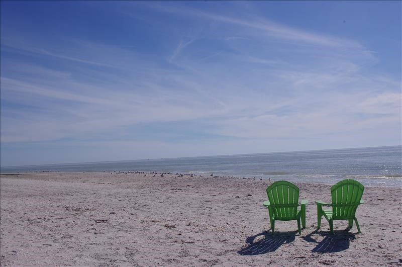 Picture yourself here - toes in the sand, beverage in hand!