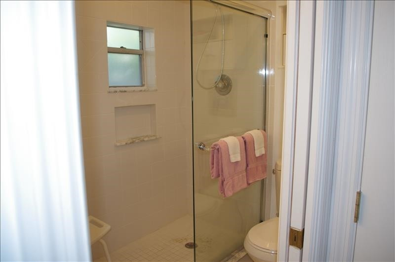 There is a full bath with walk-in shower.