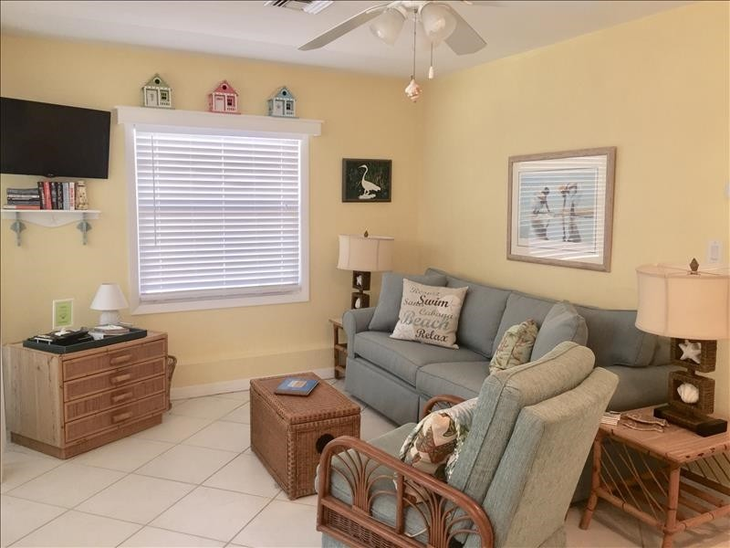 Cozy living room with room for a doggie bed.
