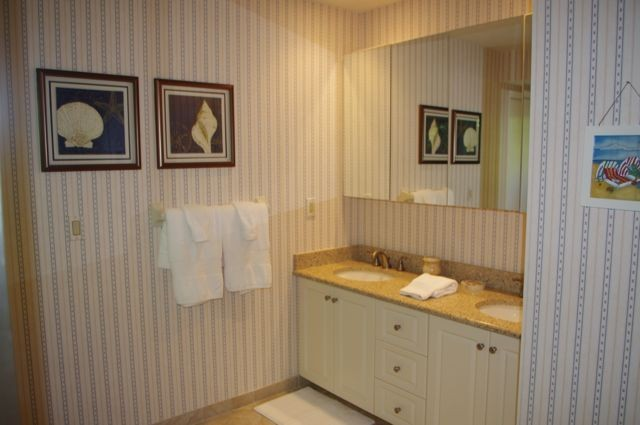 The bath has dual vanities, linen closet & walk in closet.